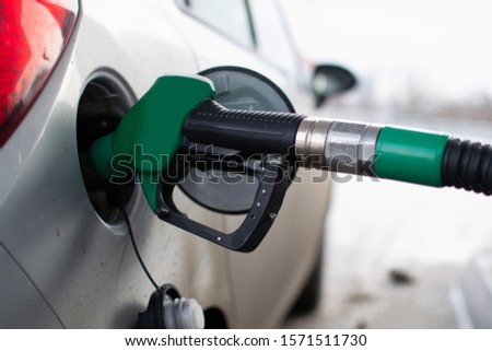 Refueling the gas tank with a green gun. #1571511730