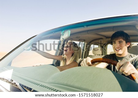 A young couple in a car #1571518027