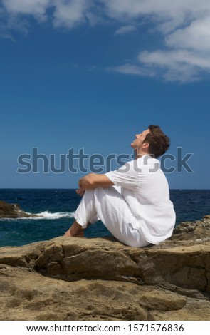 A man sitting by the sea #1571576836
