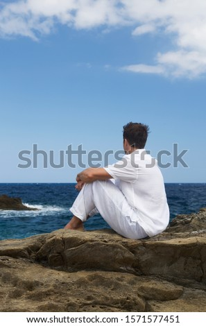 A man sitting by the sea #1571577451