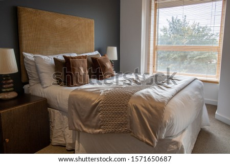 Beautiful hotel style bedroom with a large king size bed #1571650687