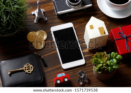 Smartphone and many miscellaneous goods Royalty-Free Stock Photo #1571739538