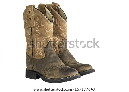 A pair of brown cowboy boots isolated on a white background. #157177649