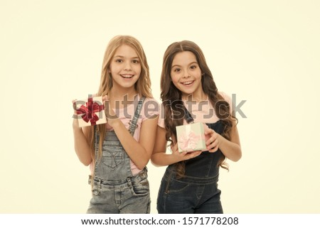 Girls sisters or friends hold gift boxes. Girls open holiday present. Children cheerful hold presents. Opening gifts. Perfect present for teens. Shopping day. Birthday present. For my dear friend.