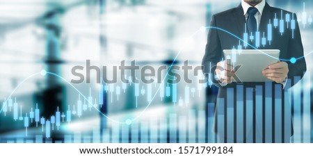 Businessman plan graph growth and increase of chart positive indicators in his business,tablet in hand #1571799184