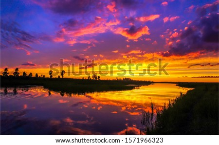 Sunset time  river water horizon view. Sunset river horizon landscape. Sunset river view. Sunset river reflection water