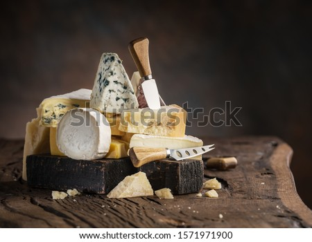 Assortment of different cheese types on wooden background. Cheese background. #1571971900