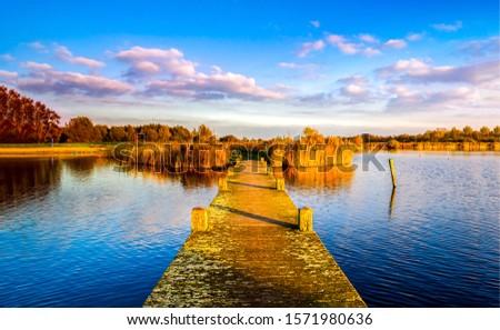 Autumn rural river pier landscape. Rural river pier in autumn. Autumn river pier view. Autumn river pier landscape #1571980636