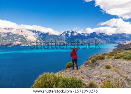 Woman tourist hiking, Chile travel, Bertran lake and mountains beautiful landscape, Chile, Patagonia, South America  #1571998276