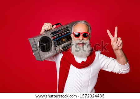 Portrait of his he nice handsome cheerful cheery positive carefree gray-haired man in pullover sweater having fun vintage festive showing v-sign isolated over bright vivid shine red background #1572024433