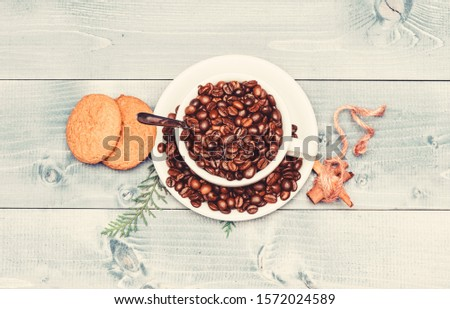 Cafe drinks menu. Arabica robusta coffee variety. Beverage for inspiration and energy charge. Fresh roasted coffee beans. Cup full coffee brown roasted bean blue wooden background. Caffeine concept. #1572024589