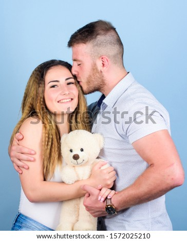 Valentines day holiday. Soft toy teddy bear gift. Man and woman couple in love. Romantic surprise. Man and pretty girl in love. Family love. Guy and girl cuddling. Enjoying each other. Happy family. #1572025210