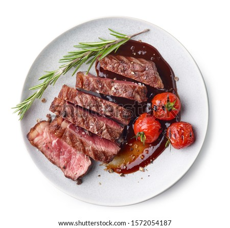 Grilled sliced Beef Steak with tomatoes and rosemary on a plate Isolated on white background top view #1572054187