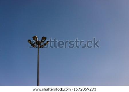 Sports spotlights that illuminate the park #1572059293
