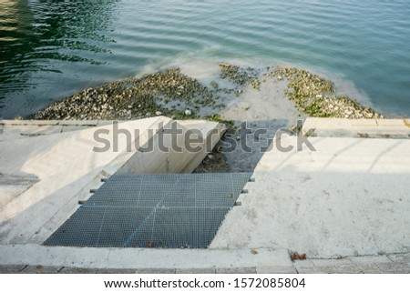 sewage flows into the river #1572085804