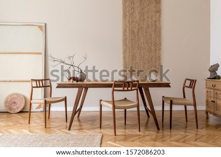 Stylish and beige interior of dining room with design wooden table and chairs, vase with flowers, elegant and rattan accessories. Korean style of home decor. Wooden parquet. Template. #1572086203