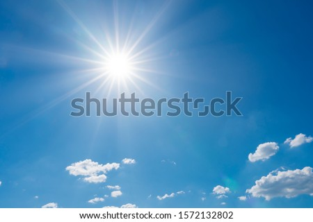 beautiful nature of blue sky with clouds and sun shines bright in the day Royalty-Free Stock Photo #1572132802