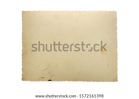Old vintage scratched photo isolated on white background.