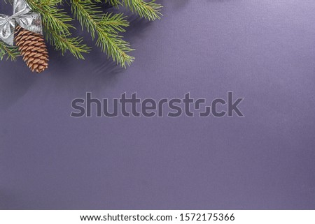 Lilac background for a letter to Santa Claus. Background for a Christmas card. Decorated with fir cones, fir branches,  #1572175366
