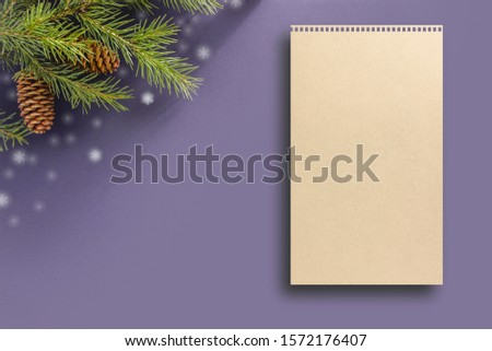 Lilac background for a letter to Santa Claus. Background for a Christmas card. Decorated with fir cones, fir branches, snowflakes, Christmas toys. #1572176407