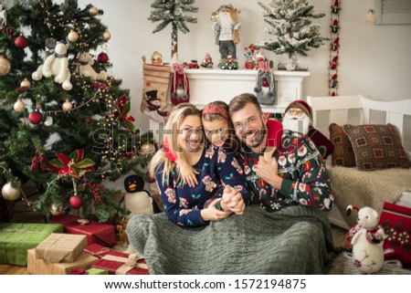 Christmas has always been a time for family for them. Parents with daughter at home. #1572194875