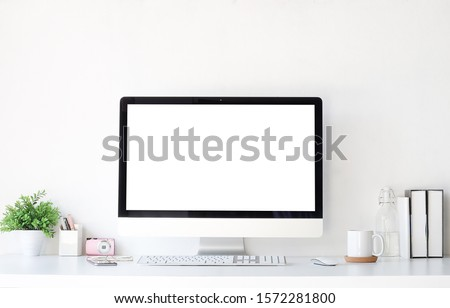 Work place concept Mockup blank screen  Office desk Workspace stuff with notepad, laptop and coffee cup mouse notepad shot.