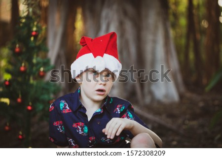 Young boy making silly faces in Christmas photos
