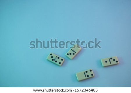 Beautiful vintage domino in the color light. Background banner texture. Top View. #1572346405