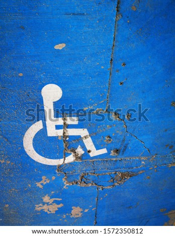 traditional icon for disabled zone only white paint on vivid blue surface #1572350812