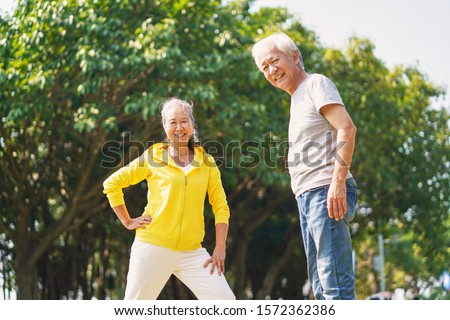 happy senior asian couple exercising outdoors in park #1572362386