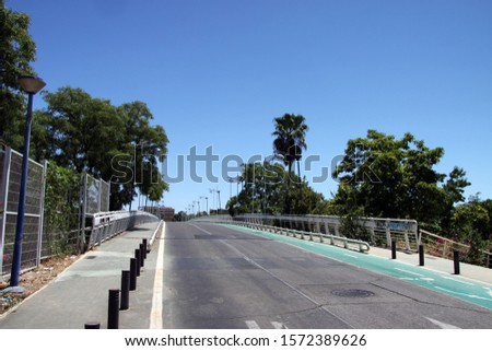 SEVILLE, SPAIN - JULY 17, 2011: Road on the island of Cartuja in Seville #1572389626