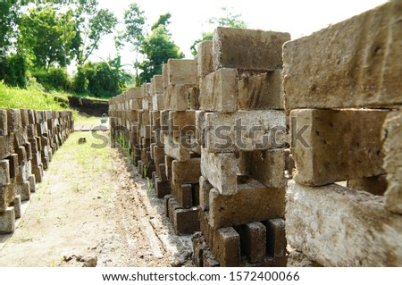 Brick is one of the materials for making walls and made of clay which is burned to reddish color #1572400066