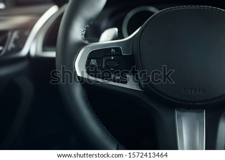 car interior, modern car speedometer and dashboard details. Dashboard and steering wheel #1572413464
