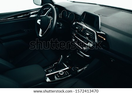 car interior, modern car speedometer and dashboard details. Dashboard and steering wheel #1572413470