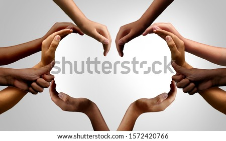 Diverse people working together and group unity or diversity partnership as teamwork cooperation or togetherness collaboration concept with hands joined together as connected citizens. Royalty-Free Stock Photo #1572420766