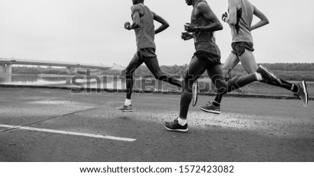 group runners athlete running marathon black and white photo