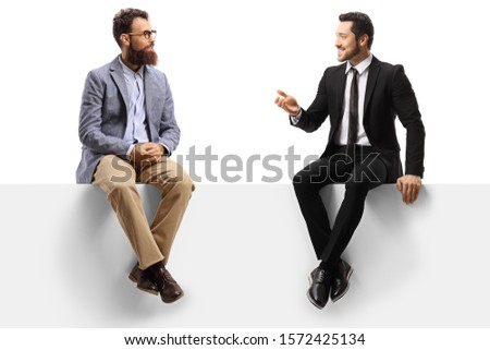 Two men sitting on a panel and having a conversation isolated on white background Royalty-Free Stock Photo #1572425134