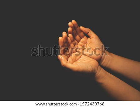 Woman hands praying for hope and faith #1572430768