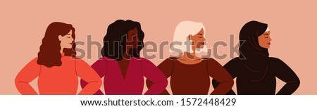 Four women of different nationalities and cultures standing together. Women's friendship, union of feminists or sisterhood. The concept of the female's empowerment movement.  Royalty-Free Stock Photo #1572448429