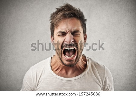 portrait of young angry man Royalty-Free Stock Photo #157245086