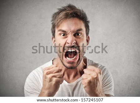 portrait of young angry man Royalty-Free Stock Photo #157245107