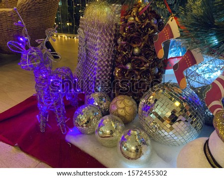 Christmas tree decoration With purple dolls and glass balls adorned with mirrors #1572455302
