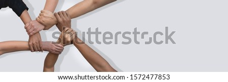 Business people united hands together in teamwork on white background with copy space for header. #1572477853