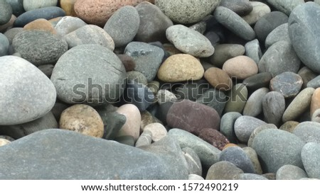 Stones, stones, stones that have explored all the power of water and become sea pebbles. #1572490219