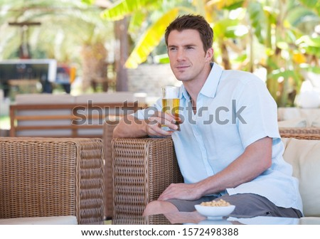 A man relaxing with a drink #1572498388