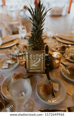 Wedding centrepiece including a pineapple #1572649966