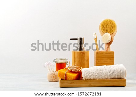 Bamboo acessories for bath - bowl, soap dispenser, brushes, tooth brush, towel and organic dry shampoo for personal hygiene. Zero waste, plastic free, sustainable decor for bathroom interior #1572672181