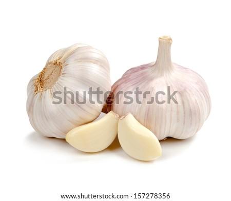 Fresh garlic isolated on white background Royalty-Free Stock Photo #157278356