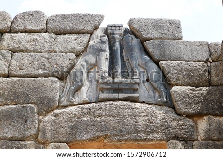 Top sculpture of ancient lion gate in mycenae, town of bronze age in greece #1572906712