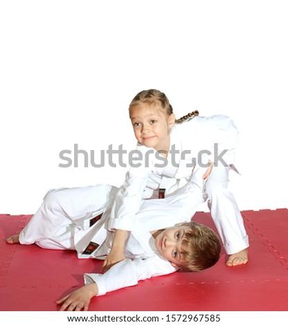 The throw are training little athletes in white karategi Royalty-Free Stock Photo #1572967585